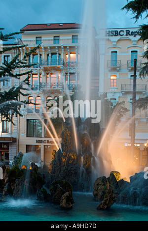Switzerland Tessin Lugano old city center fountain twilight  - Stock Photo