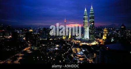 Panoramic view at dusk over KLCC area of Kuala Lumpur city to Petronas Twin Towers Malaysia - Stock Photo