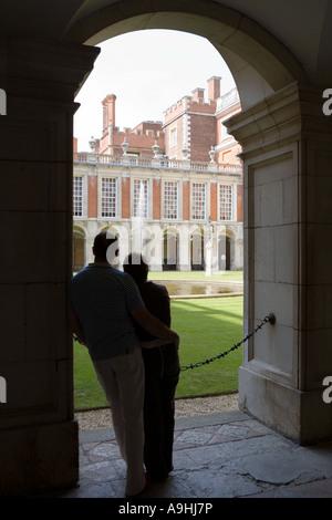 Couple admiring Hampton Court Palace - Stock Photo