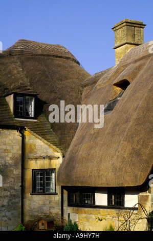 A thatched cottage in the Stanton, Cotswold, UK - Stock Photo