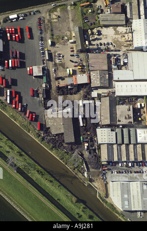 Vertical aerial view of a bus depot and commercial units on Hastingwood Trading Estate in Edmonton, North London - Stock Photo