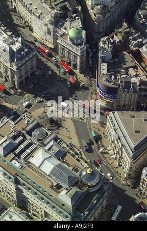 Aerial view of Piccadilly Circus in the West End of London, featuring the neon signs as well as the fountain and - Stock Photo