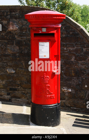 Bright red English Post Box. - Stock Photo