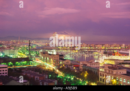 ESP Spanien Barcelona panoramic view from Montjuic hill colomus statue harbour thunderstorm - Stock Photo