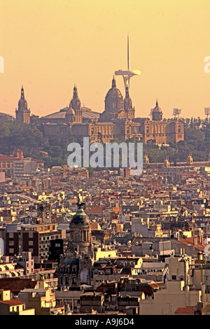 ESP Spanien Barcelona Palau National Olympic Tower Montjuic by architect Norman Forster Teleshot from Sagrada Familia - Stock Photo