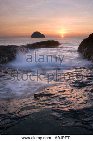 Sunset at Trebarwith Strand, Cornwall, England - Stock Photo