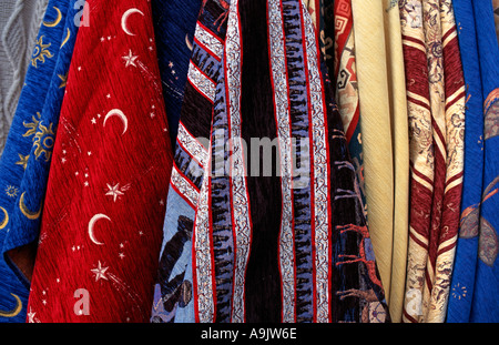 Display of woven fabrics with distinctive motifs for sale at souvenir markets in the Zelve and Goreme valleys Cappadocia - Stock Photo