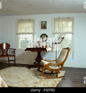 cream rug on dark wood polished floor in white bedroom with leather