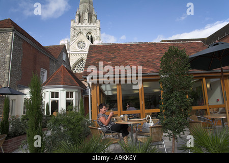 woman at Tea room  Chichester Cathedral sussex england - Stock Photo