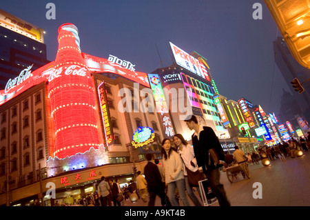 GIANT COCA COLA BOTTLE AND OTHER NEON SIGNS IN BUSY PEDESTRIANIZED SHOPPING AREA OF NANJING DONGLU SHANGHAI CHINA - Stock Photo