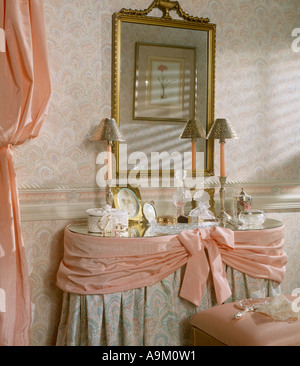bed room bedroom set interior wallpaper dressing table lamp mirror pink drapes elegant elegance - Stock Photo