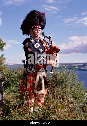dh Scottish highlander BAGPIPES SCOTLAND Kilt Highland Clan dress highlands bagpiper lone piper playing traditional tartan music man