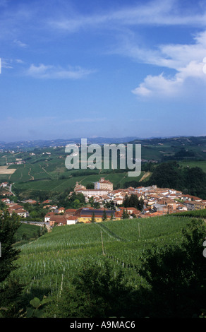 scenery with green hills a vineyards of th wine region Langhe with view to the village Barolo Piemont Italy Europe - Stock Photo