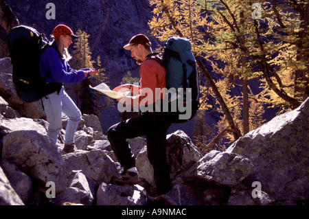 A couple using a map and compass near Blue Lake WA - Stock Photo