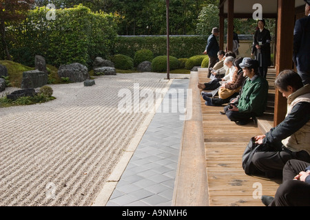Visitors enjoy the zen rock garden at Korin-in, which is a subtemple of Daitokuji Temple. Kyoto, Japan - Stock Photo