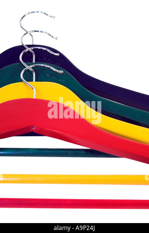 Colorful set of clothes-hangers isolated on white - Stock Photo