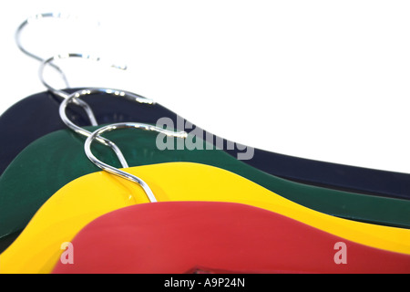 Colorful clothes hangers isolated on white - Stock Photo