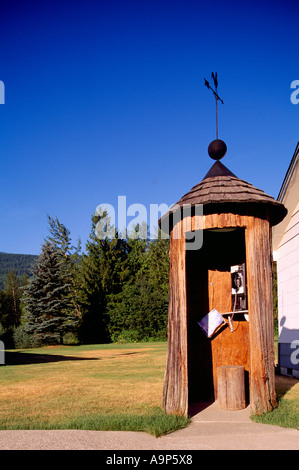 The World's Oldest Telephone Booth inside a Cedar Tree Trunk in Salmo in the Kootenay Region of British Columbia - Stock Photo
