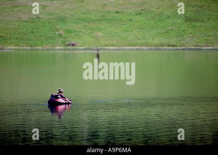 Fisherman sport fishing in Belly Boat in Nicola Lake near Merritt, Nicola Valley, BC, British Columbia, Canada - Stock Photo