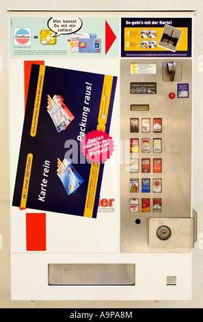 Detail of German cigarette vending machine - Stock Photo