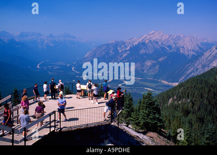 Visitors at Viewpoint on Sulphur Mountain above Town of Banff in Banff National Park in the Canadian Rockies in - Stock Photo