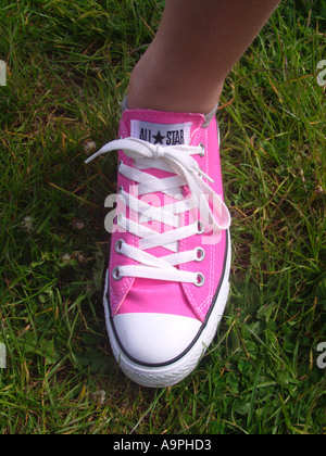 s wearing new pair of pink all trainer