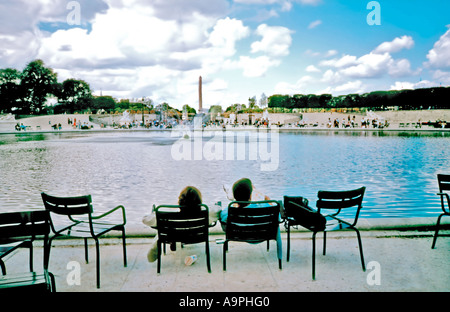 Paris France, Urban Park, Teen Couple on Park Chairs in 'Tuileries Garden' Looking to Pond Relaxation - Stock Photo