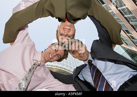 Colleagues in a huddle - Stock Photo