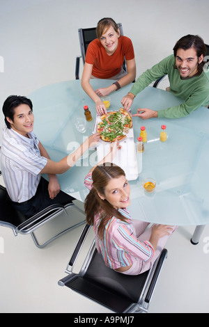 Colleagues sharing pizza - Stock Photo
