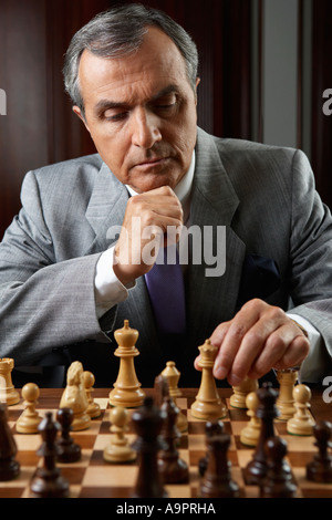 Ceo playing a game of chess - Stock Photo