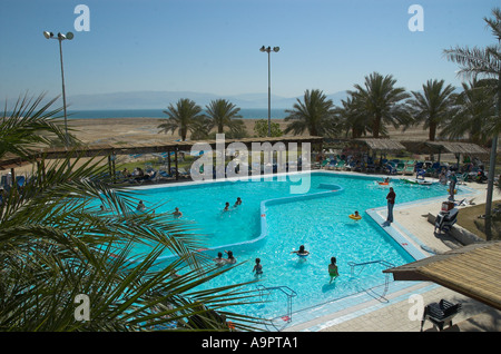 Israel Dead Sea Ein Gedi Spa the swimming pool in frgd with empty mud field and the receeding sea in bkgd - Stock Photo