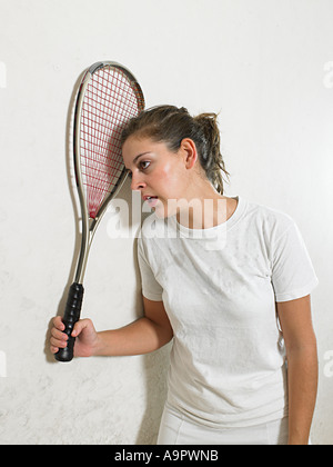 Exhausted squash player - Stock Photo