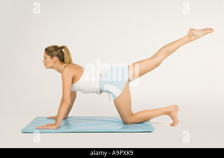 Woman stretching leg - Stock Photo