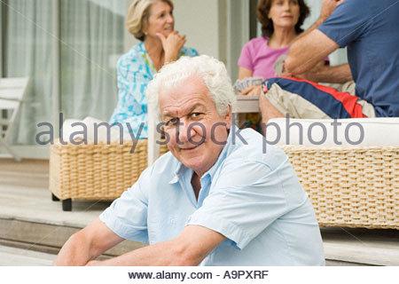 Four senior adult friends - Stock Photo