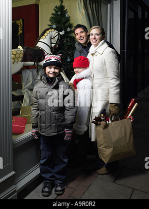 Family out christmas shopping - Stock Photo