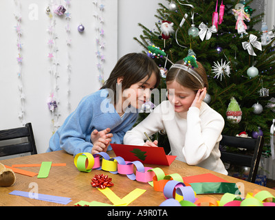 Children making christmas cards and decorations - Stock Photo