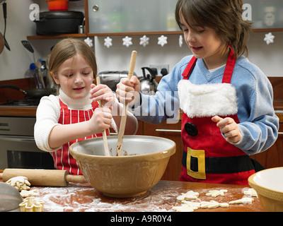 Kids making cookies - Stock Photo