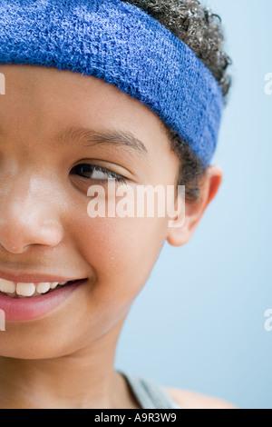 Boy perspiring wearing sports clothing - Stock Photo
