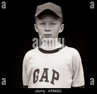 Boy wearing GAP T-shirt boy, baseball cap, school, bully, friends, games, play, playing, fashion, kids, young man, - Stock Photo