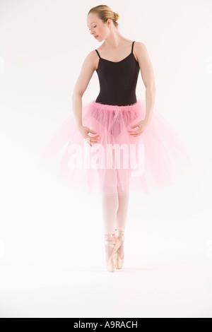 Female ballet dancer dancing on pointe - Stock Photo