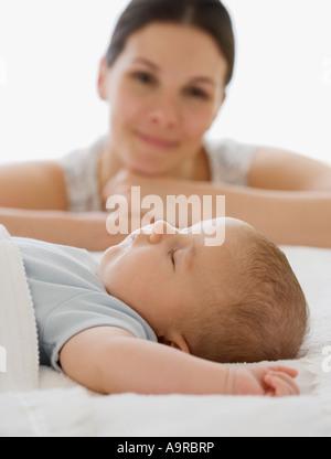 Mother watching baby sleep - Stock Photo