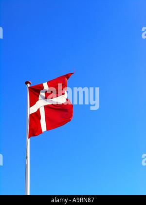 The danish flag Dannebrog waving in the wind - Stock Photo