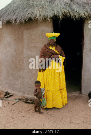 Herero woman and child wearing traditional clothes and headdress Botswana - Stock Photo