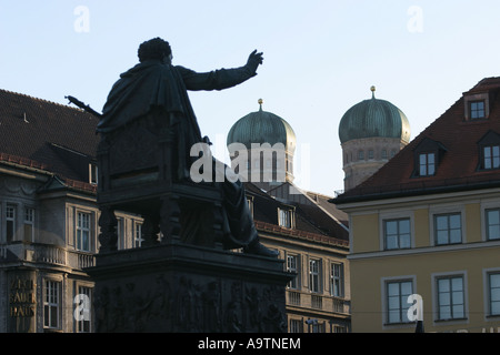 Silhouette of  the monument of Max Joseph 1st and the peaks of the Church of Our Lady  in Munich,Germany. - Stock Photo