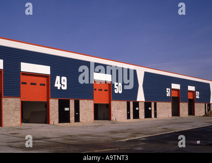 Small light industrial business units in bold colours - Stock Photo