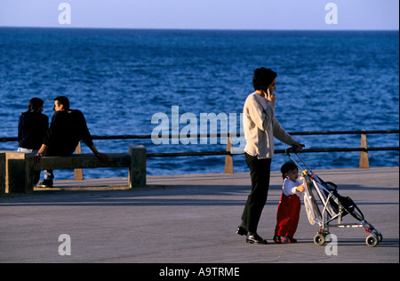 BEIRUT WEST BEIRUT COUPLE ON BENCH WOMAN WITH CHILD CORNICHE SEAFRONT AV DE PARIS 1998 - Stock Photo
