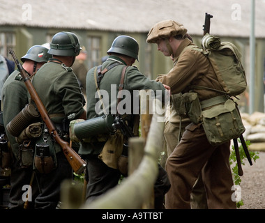 ww2 german and british army soldiers talking at glen miller festival - Stock Photo