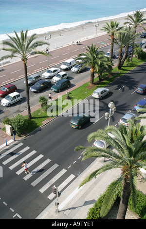 The Promenade des Anglais, looking West, viewed from the terrace of a fifth floor  appartment, Nice, France - Stock Photo