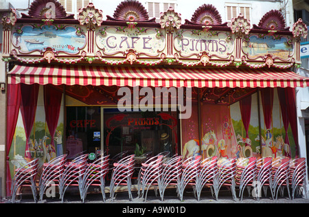 Chairs outside a French cafe - Stock Photo