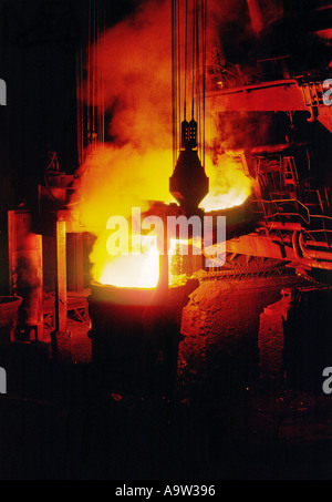 Steel furnace pouring charging molten steel into AOD vessel during stainless steel refining at British Steel Stainless - Stock Photo
